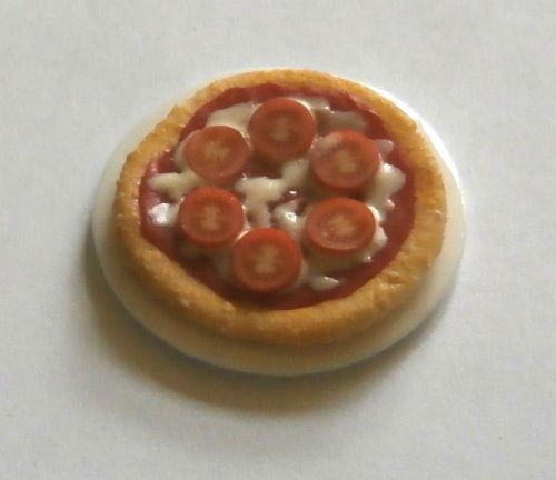 Cheese and Tomato Pizza on a plate.