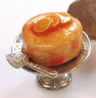 Orange Drizzle Cake on a Silver Stand